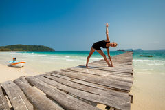Summer yoga session in beautiful tropical island Royalty Free Stock Photos