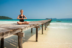 Summer yoga session in beautiful tropical island Stock Photos