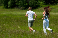 Summer - Young couple jogging in nature Royalty Free Stock Photo