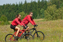 Summer - Young couple riding bike in summer stock photo