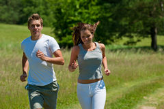 Summer - Young couple running in meadow Royalty Free Stock Image