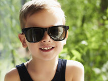 Summer young happy boy in sunglasses Royalty Free Stock Image