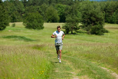 Summer - Young man with headphones jogging  Royalty Free Stock Image