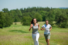 Summer - Young woman with headphones jogging Royalty Free Stock Photo