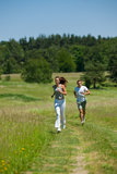 Summer - Young woman with headphones jogging Stock Photography