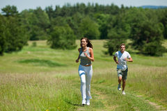 Summer - Young woman with headphones jogging Royalty Free Stock Image