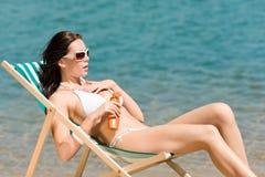 Summer young woman sunbathing in bikini Royalty Free Stock Image