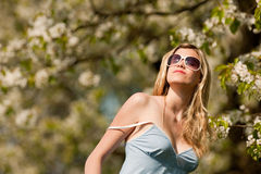 Summer - young woman under blossom tree Royalty Free Stock Photos