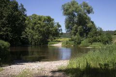 Ford wade passing pond in small forest river stock photography