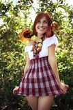 Summergirl. Red-haired girl in the apple orchard royalty free stock photos