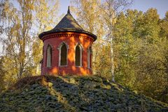Summerhouse in autumn landscape Royalty Free Stock Photos
