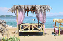 Summer dream. Summerhouse on the beach overlooking the sea Stock Images