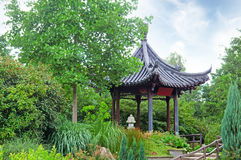 Gazebo in the Chinese style. Summerhouse in a beautiful park Royalty Free Stock Image
