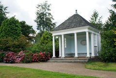 Summerhouse in a formal garden Royalty Free Stock Image