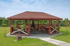Summerhouse in a garden stock photos