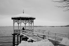 Summerhouse on the lake Bodensee. The pavilion is covered with snow on the ice-free lake Constance in the Austrian city Bregenz Stock Photography