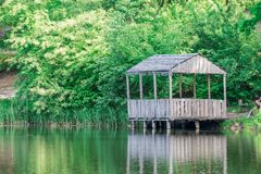 Summerhouse on the lake. On a calm summer day Stock Photo