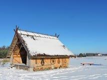 Summerhouse near lake in winter Stock Image