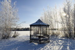 Summerhouse on the shore of a frozen lake Stock Photography