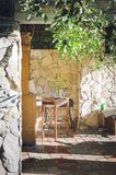 Summerhouse for summer holidays, finished with stone. Interior of a country house, summer vacation stock photography