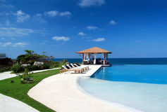 Summerhouse with swimming pool near ocean stock photography