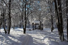 Summerhouse in winter park Royalty Free Stock Photos