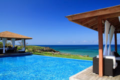 Summerhouses with swimming pool near ocean stock photography