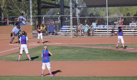 A Summerlin Little League Girls Softball Game. SUMMERLIN, NEVADA - JUNE 4: A Summerlin Little League girls game on June 4, 2015, in Summerlin, Nevada. The batter Royalty Free Stock Photo