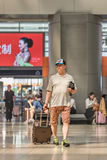 Summerly dressed man at Beijing Railway Station South, China Stock Image
