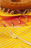 Summerly table setting. An summer party table setting with fork, napkin and dish Royalty Free Stock Photo