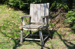 A summers chair. A wooden chair  with shadows casted over it Royalty Free Stock Photography
