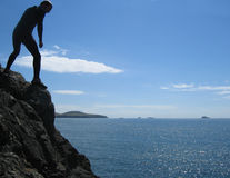 A summers day on the coast of Wales. Cliff jumping on the Western coast of Wales Stock Photos