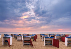 After a Summers day. The empty beach cabana's at the end of a summersday Royalty Free Stock Images