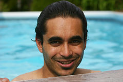 Summers in the pool. Attractive man at the poolside stock photo