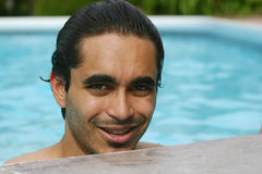 Summers in the pool. Attractive man at the poolside stock image