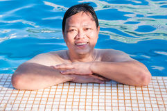 Summers in the pool. Middle age asia man in a swimming pool Royalty Free Stock Photography