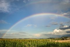 Bright double rainbow over the romanian countryside. stock photography