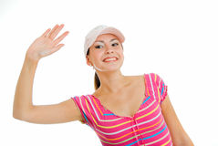 Summers salute. Smiling girl in cap on white Stock Image