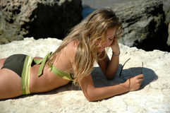 Summertime. Attractive young woman on sicilian rocks Stock Photography