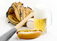 Summertime. A still life concept of one of americas favorite summertime pastime, a ball, a mitt, a bat, plus eats and drinks Stock Images