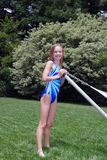 Summertime. Young girl in her backyard in swim suit Royalty Free Stock Photo