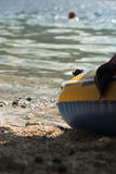 Summertime. Rubber boat on a beach of a lake Stock Photos
