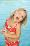 Summertime. Adorable little blond girl in red swimsuit Royalty Free Stock Image