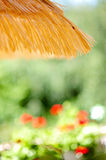 Summertime. Bast parasol and summery background Stock Photo