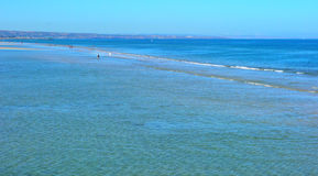 Summertime beach landscape background. At low tide Stock Photos