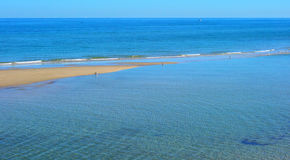 Summertime beach landscape background. At low tide Royalty Free Stock Photography