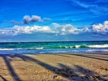 The summertime beach. Summertime at the seashore, beach, sand, turquoise Royalty Free Stock Images