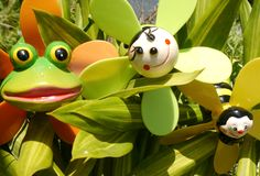 Summertime beachparty beach fun cocosnut pool. Frog and toys stock photos