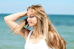 Summertime. Beautiful young women. With long blond hair Royalty Free Stock Photos