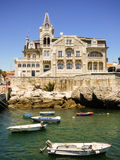 Summertime in Cascais - Fishing gear and boats with Seixas Palace in the background stock images